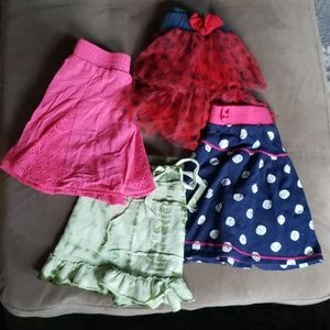 4 girl's skirts (size 6)